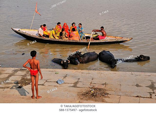Pilgrims enjoying sight seeing boat trip by the ghat