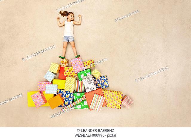 Children with heaps of birthday presents
