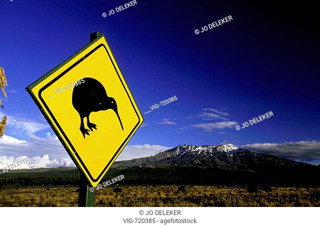 NEW ZEALAND, TONGARIRO NATIONALPARK, 10.02.2005, A kiwi-sign in Tongariro-NP in front of Mount Ruapehu. - TONGARIRO NATIONALPARK, NEW ZEALAND, 10/02/2005