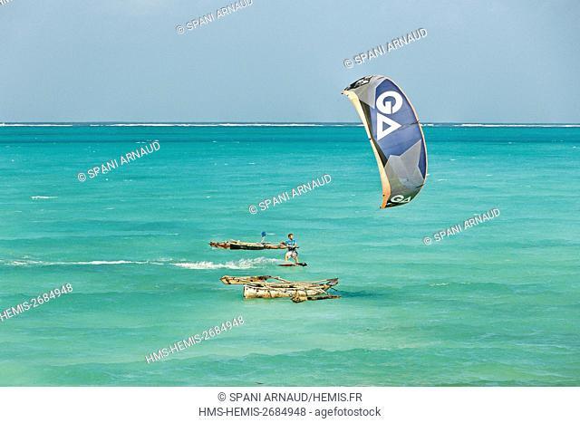 Tanzania, Zanzibar, Jambiani, practicing sports kite surd in the turquoise waters of a tropical lagoon