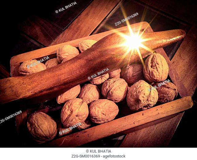 Walnuts in a wood box with a swan neck lever which can be used to crack the nuts, Ontario, Canada