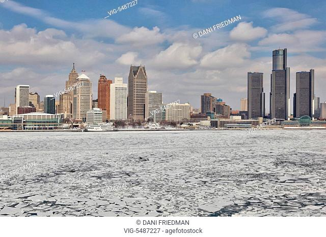 Skyline of downtown Detroit, Michigan, USA. Chunks of ice can be seen floating along the Detroit River on a cold Winter day
