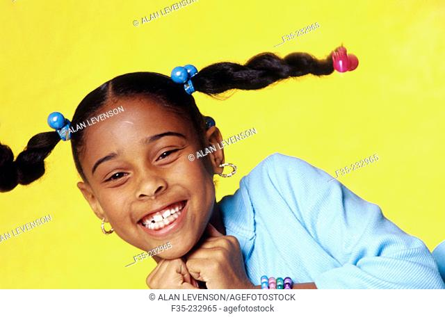 Happy young girl with braids