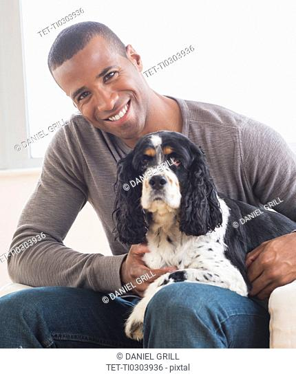 Young man with cocker spaniel