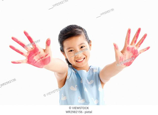 Portrait of a girl with arms outstretched