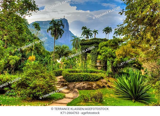 Tropical vegetation covers a pagoda at the Botanical Gardens in Rio de Janeiro, Brazil