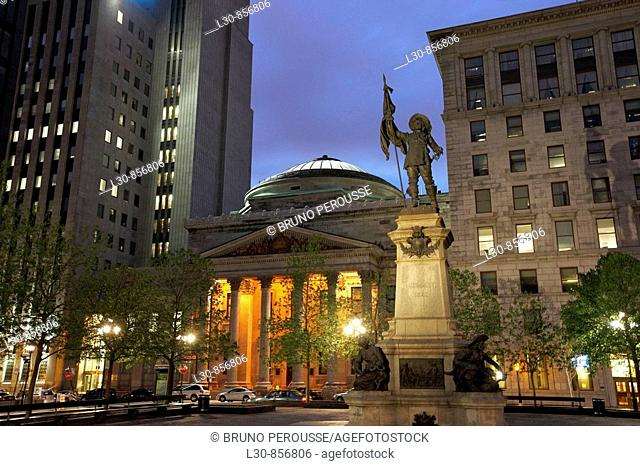 Statue of Paul de Chomedey de Maisonneuve and Bank of Montreal in Place d'Armes square, Montreal, Quebec, Canada