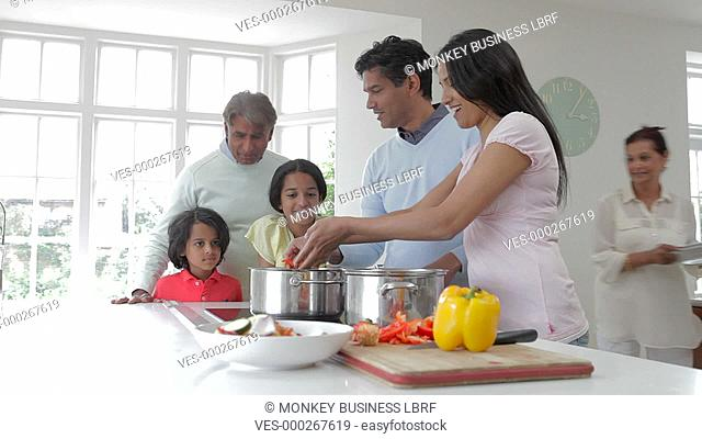 Extended Asian Indian family preparing meal together in kitchen.Shot on Canon 5d Mk2 with a frame rate of 25fps