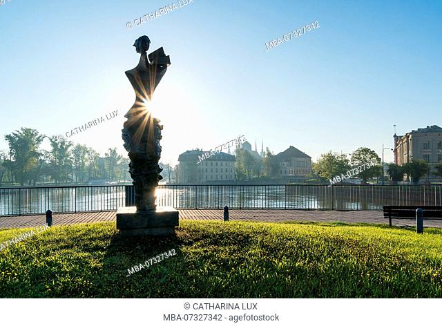 Poland, Wroclaw, University Bridge, 'Powodzianka' sculpture, commemoration of the 1997 Oder Flood, woman with books on her shoulder