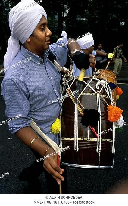 Close-up of a young man playing a drum, London, England