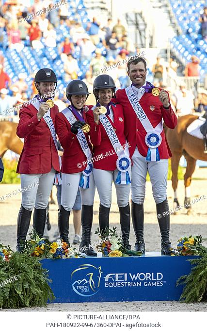 21 September 2018, US, Tryon: Equestrian - Jumping: World Championship, Jumping, Nations Cup, 2nd round (team decision): The team from the USA (from left:...