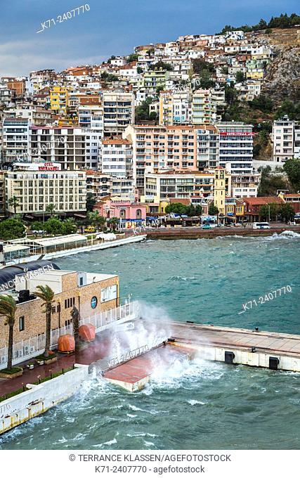 Waves crashing into a dock in the port of Kusadasi, Turkey, Eurasia