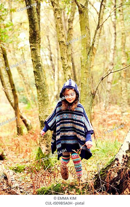 Young girl, walking through forest