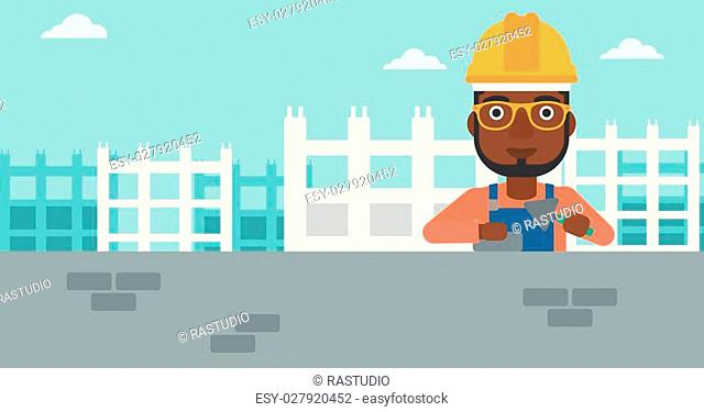 An african-american bricklayer with a spatula and a brick in hands on a background of construction site vector flat design illustration