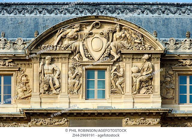 Paris, France. Palais du Louvre. Cour Carree - detailed carved stone relief