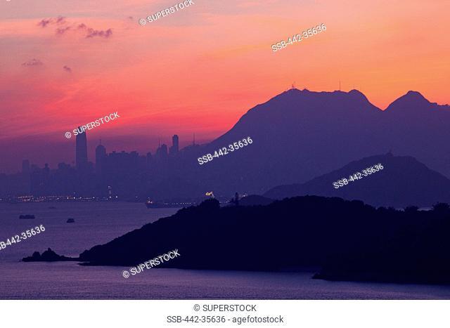 City with mountains at dawn, Hong Kong, China