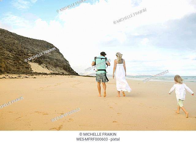 Spain, Fuerteventura, Jandia, family walking on beach