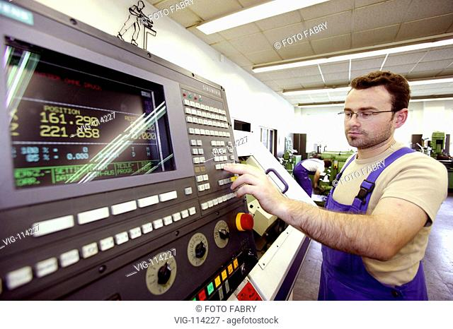 Training workshop of the town department of works Karlsruhe, training to precision mechanic, trainee at a computer-controlled machine tool