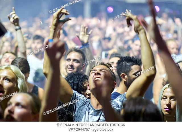 party crowd cheering at DJ Afrojack at music festival Starbeach in Hersonissos, Crete, Greece, on 02. August 2017