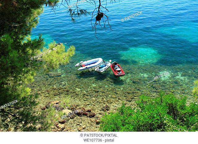Boat and two PWCs moored in Adriatic Sea, Zivogosce, Croatia