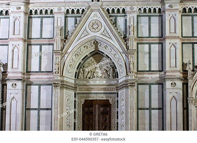 Close up of the doorway of Holy Cross church in Florence