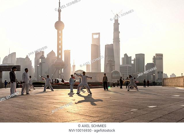 Chinese people practicing Tai Chi, promenade, the Bund, Shanghai, China