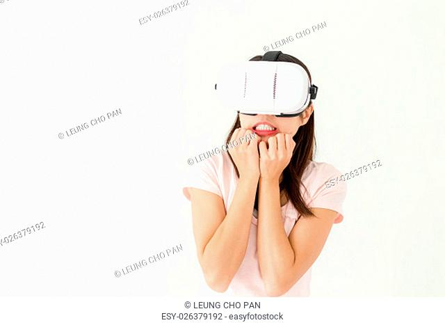 Woman watch scary movie via VR device