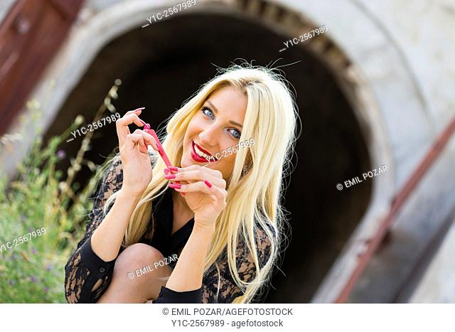 Young lady brushing her nails with abrasive pad