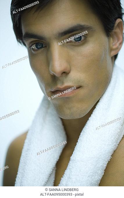 Man with towel around neck, portrait