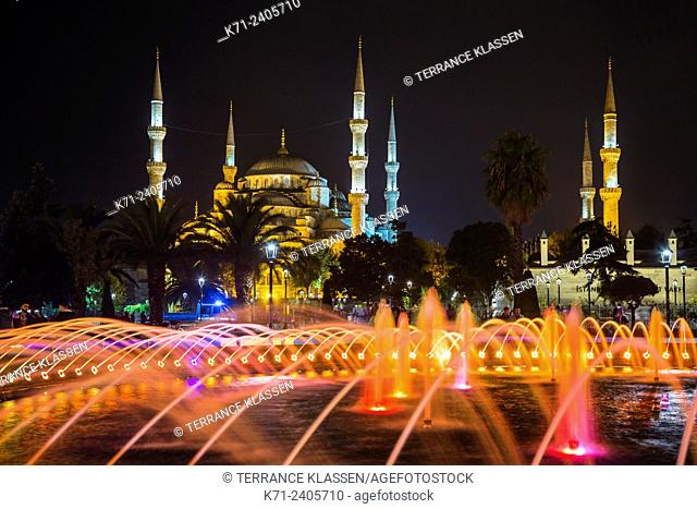 Decorative colored water fountains and the Blue Mosque in Sultanahmet, Istanbul, Turkey, Eurasia