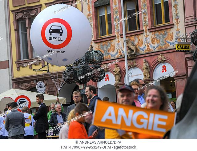 The environmental organisation Greenpeace protests against the Diesel policies before the event of the German chancellor with a giant balloon in Mainz, Germany