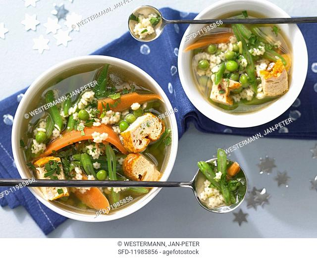 Soup with star-shaped mini pasta, custard royale and vegetables