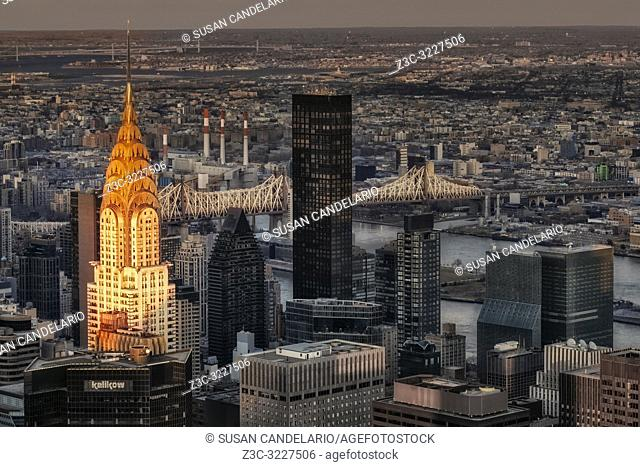 Chrysler Building NYC Sunset - Upper view to the illuminated iconic art deco Chrysler building along with the Ed Koch Queensboro (59th Street) bridge and other...