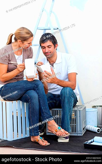 Lovers relaxing while renovating their new house