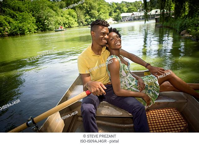Young couple on rowing lake in Central Park, New York City, USA