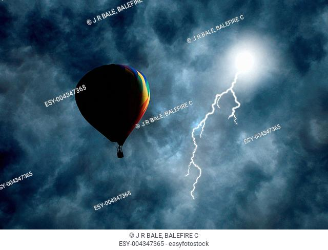 Hot-Air Balloon Among Dark Storm Clouds with Lightning