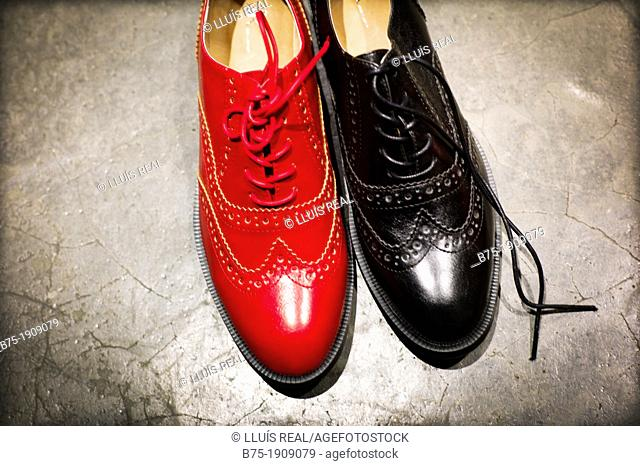 Two oxford shoes, classic English, one red and one black