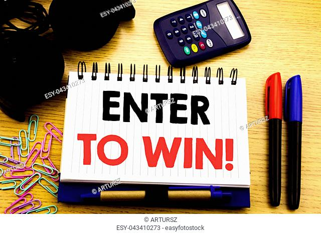 Conceptual hand writing text caption showing Enter to Win. Business concept for Winning in Competition written on notebook book on the background in the Office...