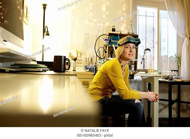 Portrait of female jewellery maker in design studio