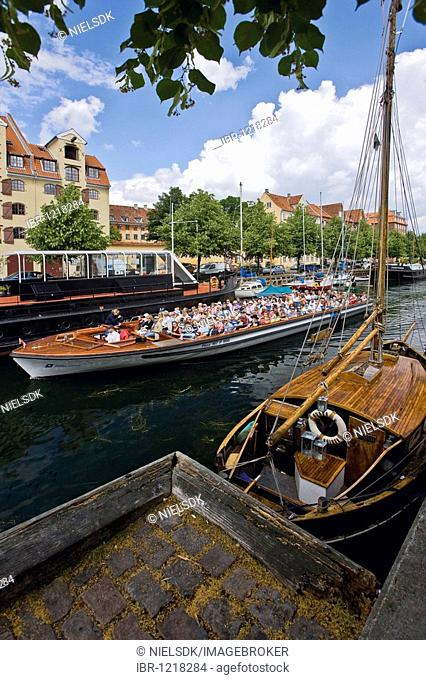 Sightseeing boat in Christianshavn canal, Copenhagen, Denmark, Europe