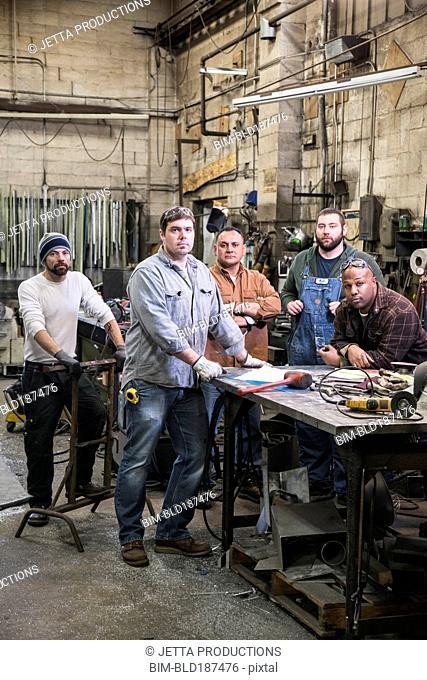 Workers standing in workshop