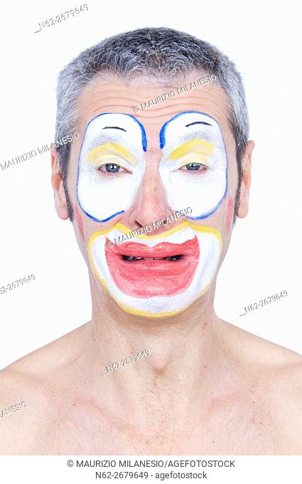 Portrait of a clown who cries shirtless front view