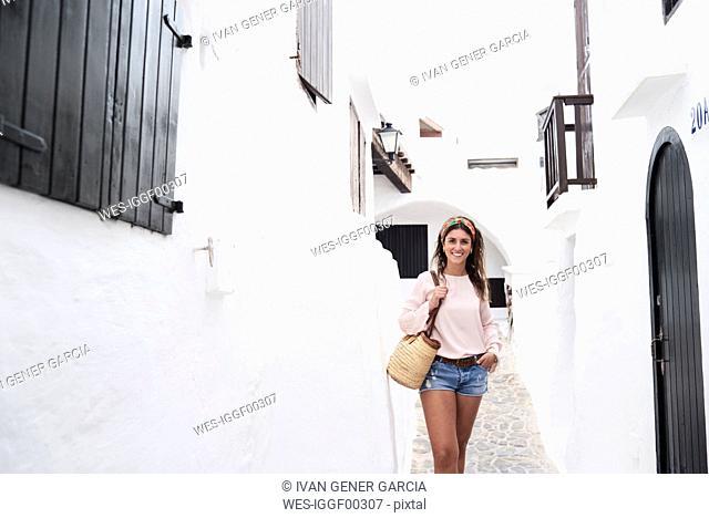 Spain, Menorca, brunette young woman smiling