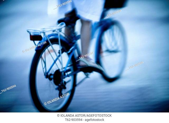 Teenager on bicycle  Motion and blur