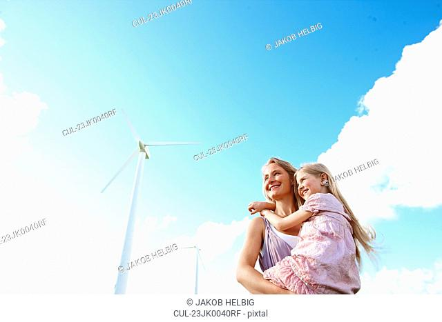 Mother and daughter at wind turbine