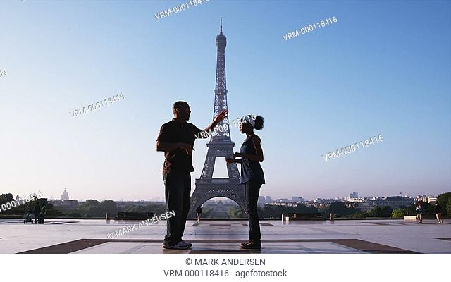 couple dancing in front of the Eiffel tower