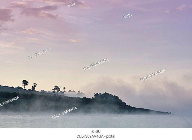 Mist over Wimbleball lake at dawn, Exmoor, Somerset, England