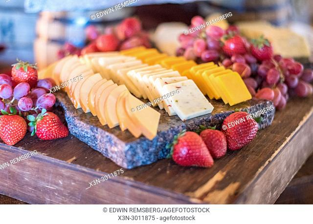 Tempting platter of assorted cheeses and fruit nicely displayed at party, Annapolis, Maryland. USA