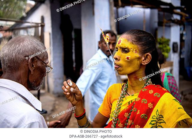 Woman tongue pierced with trident near Mutharamman temple, Tamil Nadu, India, Asia
