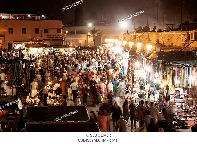 Shoppers and market stalls at night, Jamaa el Fna Square, Marrakech, Morocco
